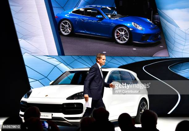 Oliver Blume chairman of the Executive board of Porsche AG presents Porschce Cayenne Turbo car at the stand of German carmaker Porsche at the...