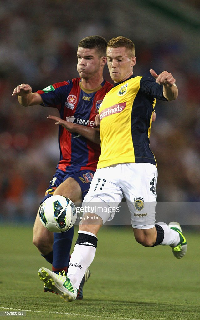 Oliver Bolzanic of the Mariners contests the ball with his Jets opponent during the round ten A-League match between the Newcastle Jets and the Central Coast Mariners at Hunter Stadium on December 8, 2012 in Newcastle, Australia.