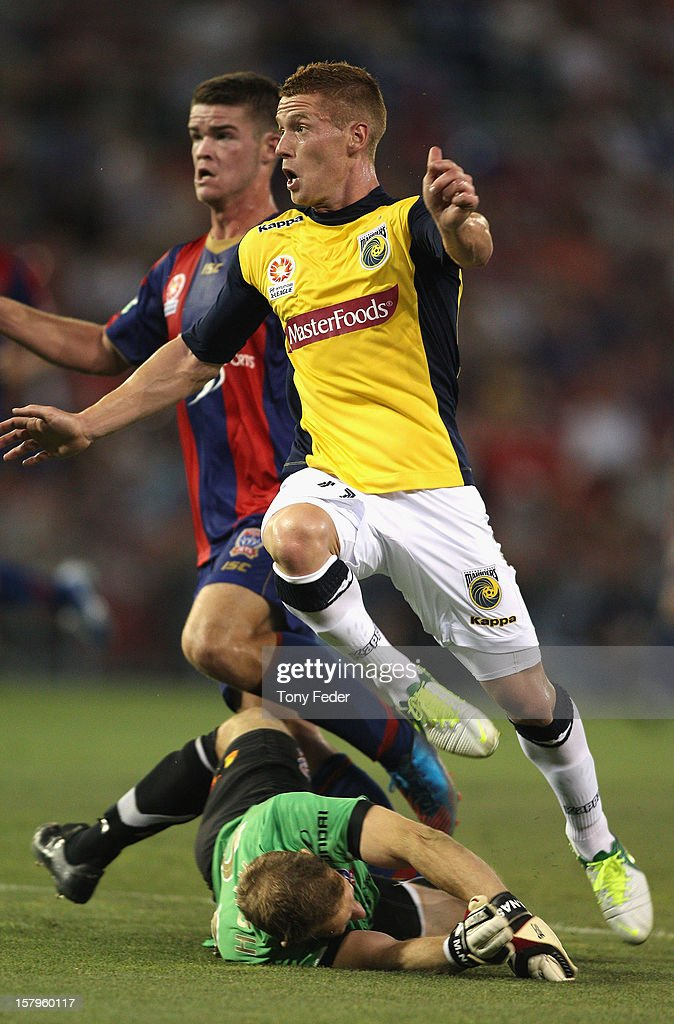 Oliver Bolzanic of the Mariners hurdles over Jets goalkeeper Matthew Nash during the round ten A-League match between the Newcastle Jets and the Central Coast Mariners at Hunter Stadium on December 8, 2012 in Newcastle, Australia.