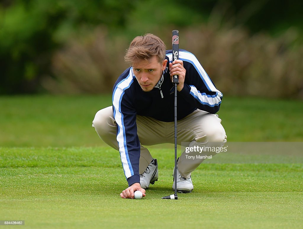 Oliver Booth of Scraptoft Golf Club lines up his putt on the 18th green during the PGA Assistants Championships - Midlands Qualifier at the Coventry Golf Club on May 26, 2016 in Coventry, England.