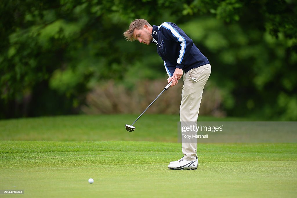 Oliver Booth of Scraptoft Golf Club putts on the 18th green during the PGA Assistants Championships - Midlands Qualifier at the Coventry Golf Club on May 26, 2016 in Coventry, England.