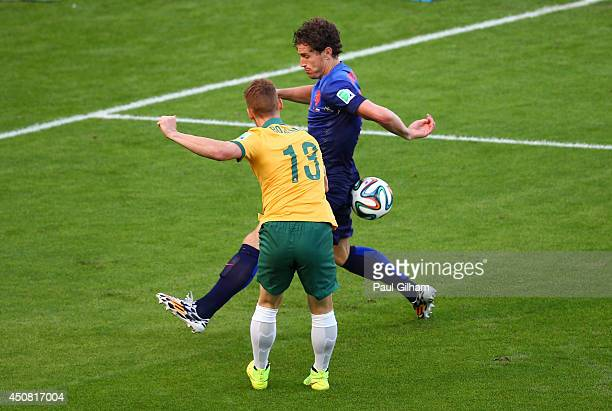 Oliver Bozanic of Australia shoots and hits the arm of Daryl Janmaat of the Netherlands during the 2014 FIFA World Cup Brazil Group B match between...