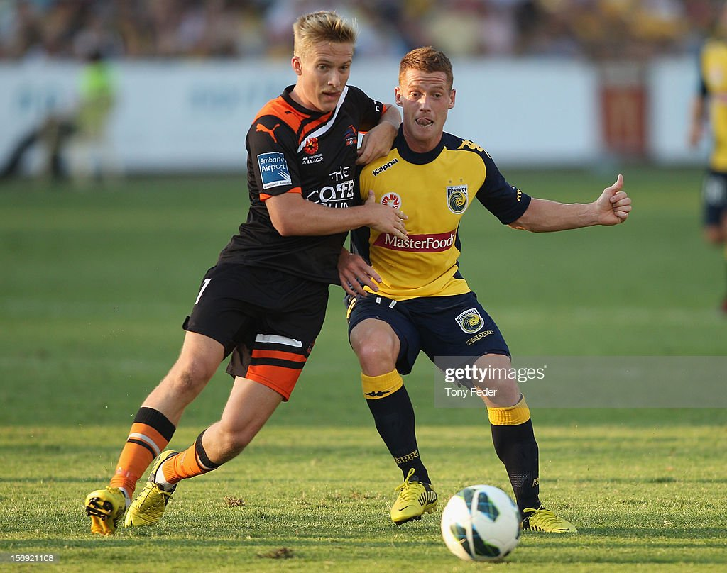 Oliver Bozanic of the Mariners and Ben Halloran of the Brisbane Roar contest the ball during the round eight A-League match between the Central Coast Mariners and the Brisbane Roar at at Bluetongue Stadium on November 25, 2012 in Gosford, Australia.