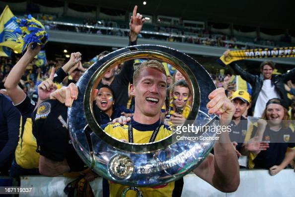 Oliver Bozanic of the Mariners celebrates with the trophy after winning the ALeague 2013 Grand Final match between the Western Sydney Wanderers and...