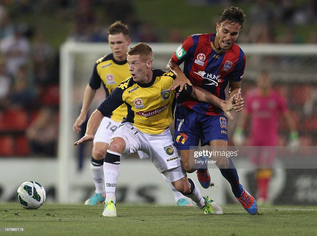 Oliver Bozanic of the Mariners contests the ball with James Brown of the Jetsduring the round ten A-League match between the Newcastle Jets and the Central Coast Mariners at Hunter Stadium on December 8, 2012 in Newcastle, Australia.