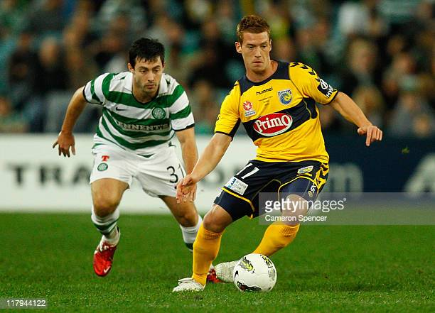 Oliver Bozanic of the Mariners controls the ball ahead of Richie Towell of Celtic during the international friendly club match between the Central...