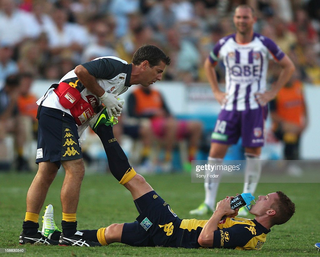Oliver Bozanic of the Mariners gets treatment for cramp during the round 14 A-League match between the Central Coast Mariners and the Perth Glory at Bluetongue Stadium on December 31, 2012 in Gosford, Australia.
