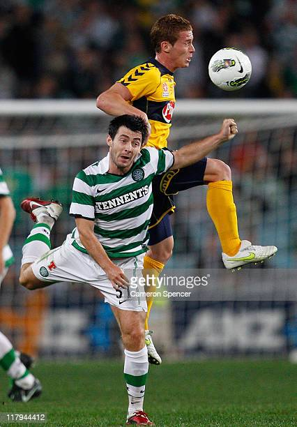 Oliver Bozanic of the Mariners heads the ball over Richie Towell of Celtic during the international friendly club match between the Central Coast...