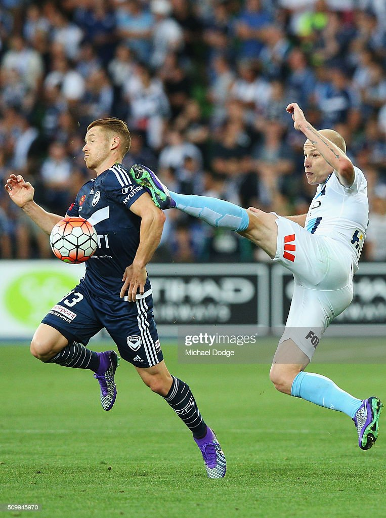 Oliver Bozanic of the Victory (L) and <a gi-track='captionPersonalityLinkClicked' href=/galleries/search?phrase=Aaron+Mooy&family=editorial&specificpeople=6342712 ng-click='$event.stopPropagation()'>Aaron Mooy</a> of the City compete for the ball during the round 19 A-League match between Melbourne City FC and Melbourne Victory at AAMI Park on February 13, 2016 in Melbourne, Australia.