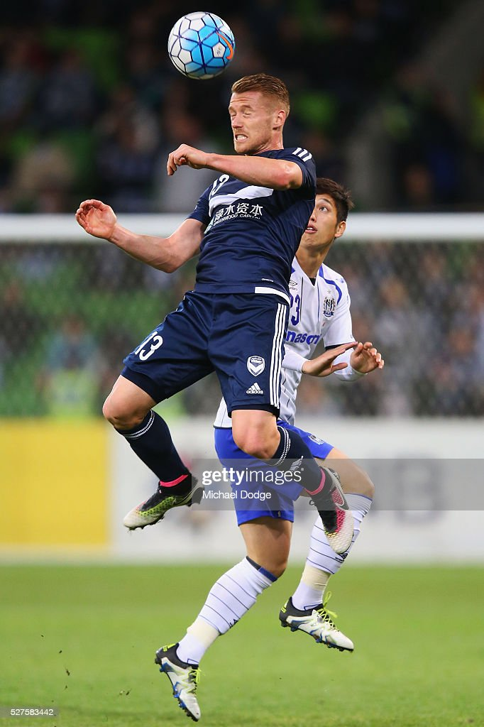 Oliver Bozanic of the Victory heads the bal against Whereto Goya of Gamba Osaka during the AFC Champions League match between Melbourne Victory and Gamba Osaka at AAMI Park on May 3, 2016 in Melbourne, Australia.