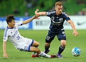 Oliver Bozanic of the Victory is tackled by Baek Jihoon of Suwon during the AFC Champions League match between the Melbourne Victory and Suwon...