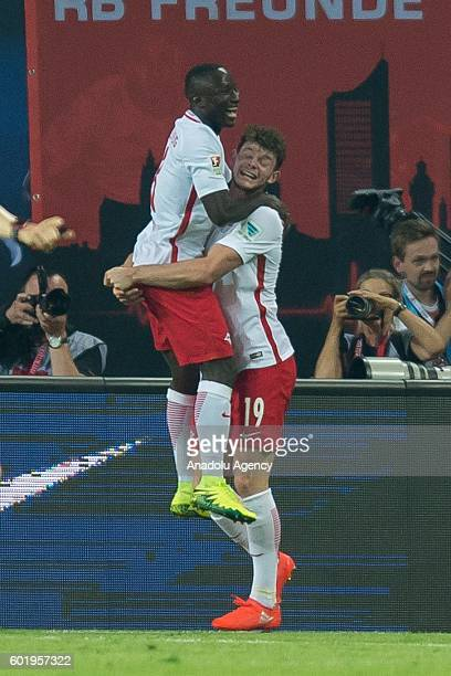 Oliver Burke and Naby Keita of Leipzig celebrate after scoring a goal during Bundesliga soccer match between RB Leipzig and BV Borussia Dortmund at...