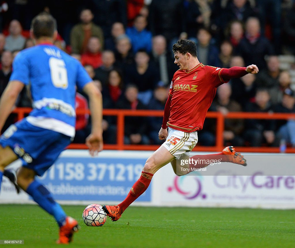 Oliver Burke of Nottingham Forest scores their first goal during The Emirates FA Cup Third Round match between Nottingham Forest and Queens Park Rangers at City Ground on January 9, 2016 in Nottingham, England.