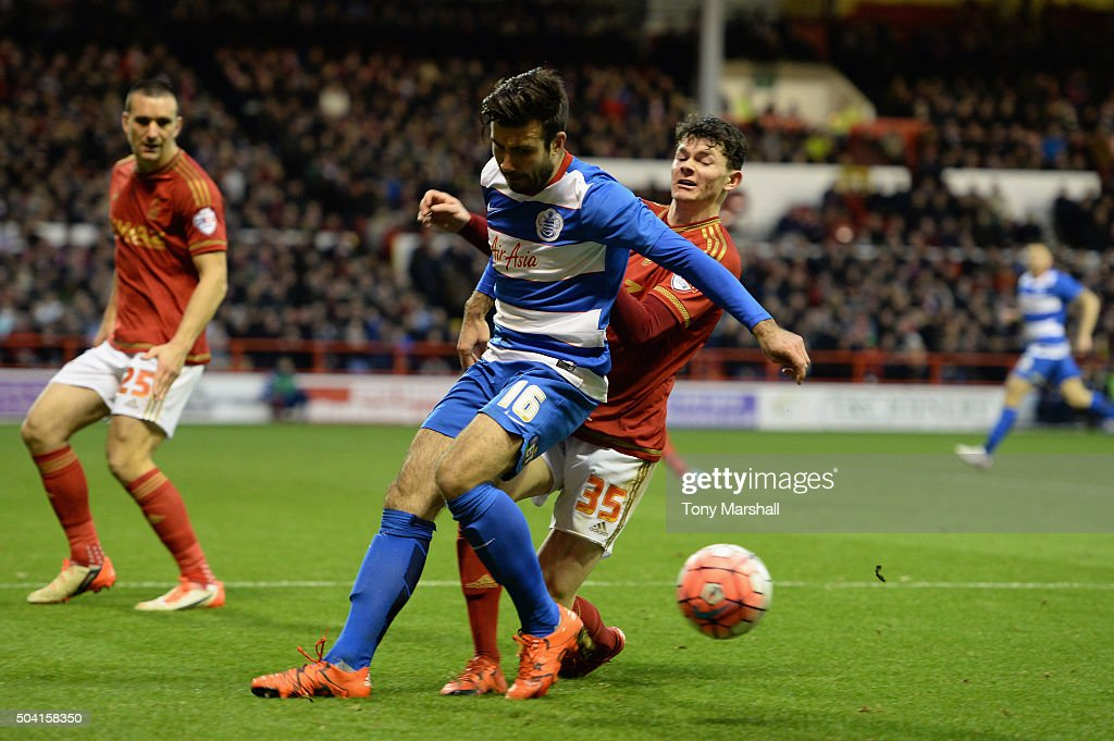 Oliver Burke of Nottingham Forest tackles Michael Doughty of Queens Park Rangers during The Emirates FA Cup Third Round match between Nottingham Forest and Queens Park Rangers at City Ground on January 9, 2016 in Nottingham, England.