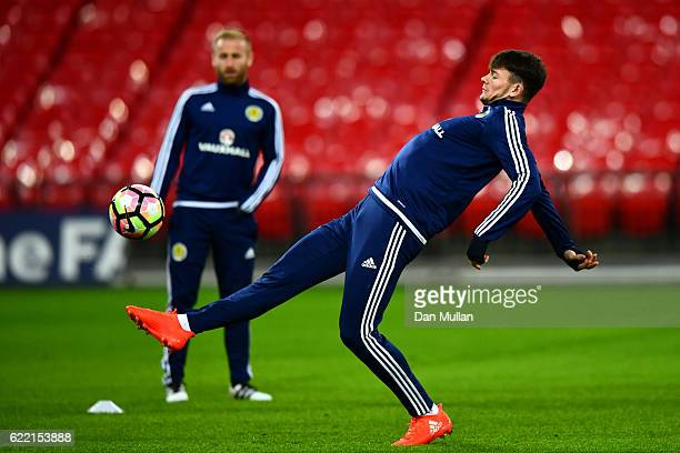 Oliver Burke of Scotland controls a ball during a training session ahead of the FIFA 2018 World Cup qualifying group F match against England at...