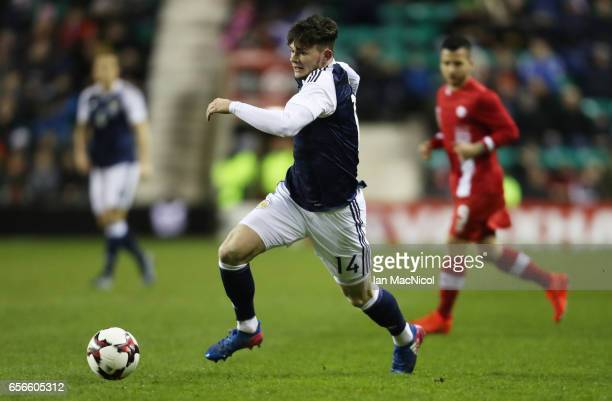 Oliver Burke of Scotland runs with the ball during the International Challenge Match between Scotland and Canada at Easter Road on March 22 2017 in...