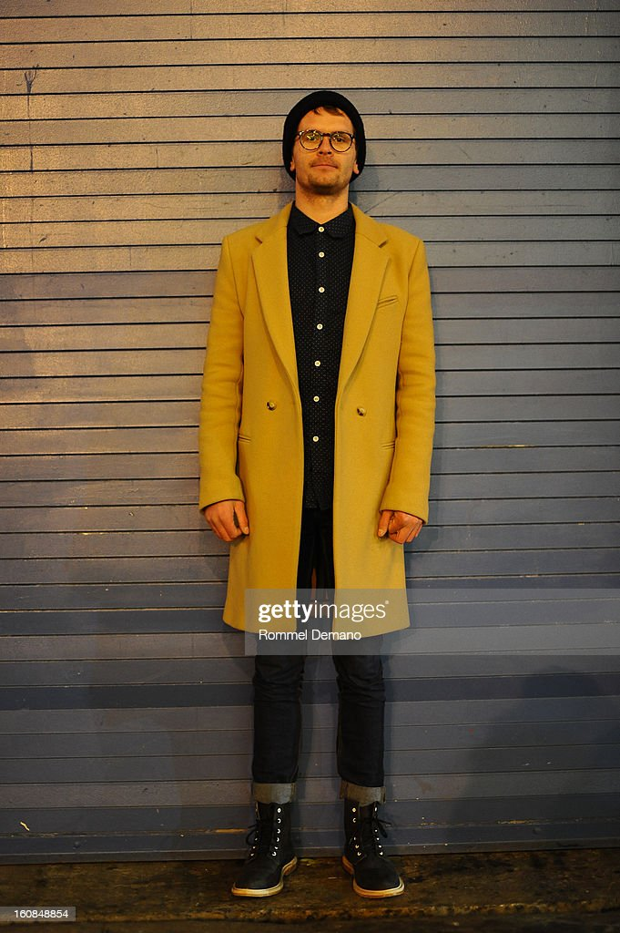 Oliver Cart from Brooklyn, is seen outside the Rachel Comey show wearing Oliver People glasses, Cheap Monday pants and Oliver Clark shoes on February 6, 2013 in New York City.
