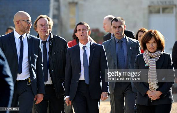 Oliver Chasson the director of Pontourny center Socialist deputy JeanPatrick Gilles French Prime Minister Manuel Valls and French Minister for Family...