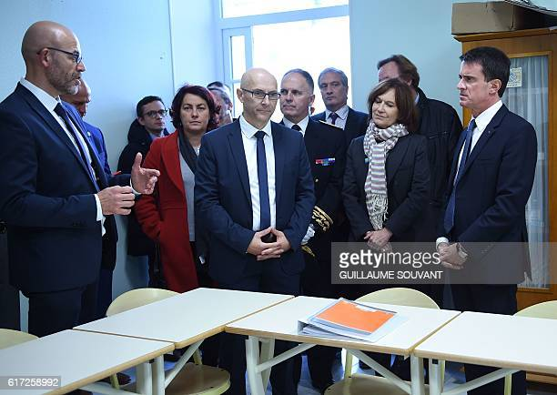 Oliver Chasson the director of Pontourny center speaks to French Prime Minister Manuel Valls and French Minister for Family Children and Women's...