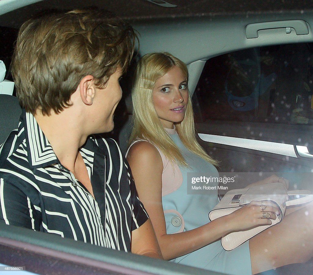 Oliver Cheshire and Pixie Lott at the Chiltern Firehouse for a Prada event on April 30, 2014 in London, England.