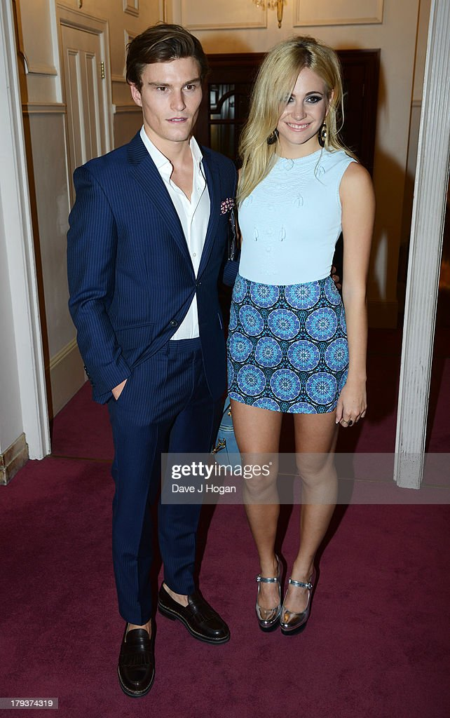 <a gi-track='captionPersonalityLinkClicked' href=/galleries/search?phrase=Oliver+Cheshire&family=editorial&specificpeople=7407100 ng-click='$event.stopPropagation()'>Oliver Cheshire</a> and <a gi-track='captionPersonalityLinkClicked' href=/galleries/search?phrase=Pixie+Lott&family=editorial&specificpeople=5591168 ng-click='$event.stopPropagation()'>Pixie Lott</a> attend Elton John's 'Brits Icon' concert at The Palladium on September 2, 2013 in London, England.