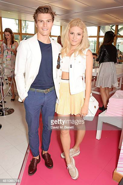 Oliver Cheshire and Pixie Lott attend the evian Live Young suite on the opening day of Wimbledon at the All England Lawn Tennis and Croquet Club on...
