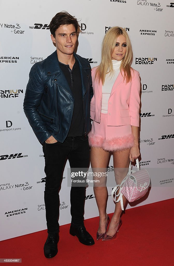 <a gi-track='captionPersonalityLinkClicked' href=/galleries/search?phrase=Oliver+Cheshire&family=editorial&specificpeople=7407100 ng-click='$event.stopPropagation()'>Oliver Cheshire</a> and <a gi-track='captionPersonalityLinkClicked' href=/galleries/search?phrase=Pixie+Lott&family=editorial&specificpeople=5591168 ng-click='$event.stopPropagation()'>Pixie Lott</a> attend the Fashion Fringe 10th anniversary party at the London Film Museum on December 3, 2013 in London, England.