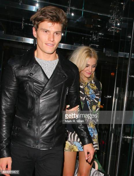 Oliver Cheshire and Pixie Lott attend the GUESS Loves Priyanka VIP Dinner at the London Edition Hotel on January 20 2014 in London England