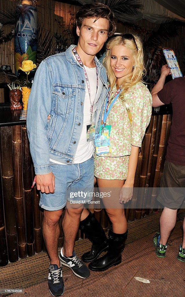 <a gi-track='captionPersonalityLinkClicked' href=/galleries/search?phrase=Oliver+Cheshire&family=editorial&specificpeople=7407100 ng-click='$event.stopPropagation()'>Oliver Cheshire</a> (L) and <a gi-track='captionPersonalityLinkClicked' href=/galleries/search?phrase=Pixie+Lott&family=editorial&specificpeople=5591168 ng-click='$event.stopPropagation()'>Pixie Lott</a> attend the Mahiki Coconut Backstage Bar during day 2 of V Festival 2013 at Hylands Park on August 18, 2013 in Chelmsford, England.