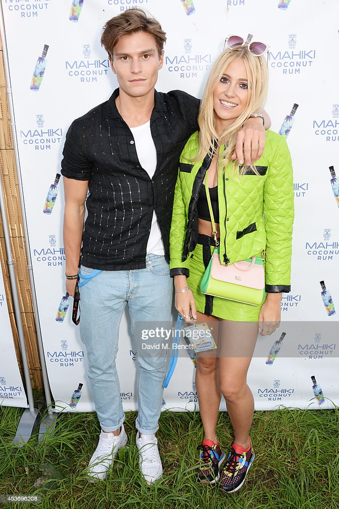 <a gi-track='captionPersonalityLinkClicked' href=/galleries/search?phrase=Oliver+Cheshire&family=editorial&specificpeople=7407100 ng-click='$event.stopPropagation()'>Oliver Cheshire</a> (L) and <a gi-track='captionPersonalityLinkClicked' href=/galleries/search?phrase=Pixie+Lott&family=editorial&specificpeople=5591168 ng-click='$event.stopPropagation()'>Pixie Lott</a> attend the Mahiki Rum Bar for the launch of the Mahiki Rum Family backstage during day 1 of the V Festival 2014 at Hylands Park on August 16, 2014 in Chelmsford, England.