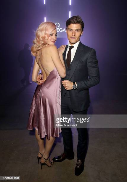 Oliver Cheshire and Pixie Lott attend the OMEGA 'Lost In Space' dinner to celebrate the 60th anniversary of the OMEGA Speedmaster which has been worn...