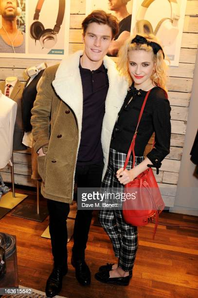 Oliver Cheshire and Pixie Lott attend the Panasonic Technics 'Shop To The Beat' Party hosted by George Lamb at French Connection Oxford Circus on...