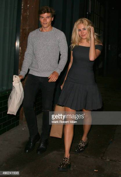 Oliver Cheshire and Pixie Lott leaving Shoreditch House on May 13 2014 in London England