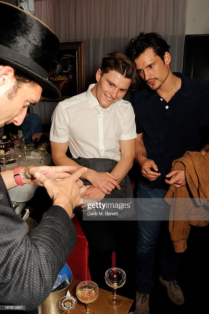 <a gi-track='captionPersonalityLinkClicked' href=/galleries/search?phrase=Oliver+Cheshire&family=editorial&specificpeople=7407100 ng-click='$event.stopPropagation()'>Oliver Cheshire</a> (C) and Sam Webb attend the launch of Baroque's new cabaret show at the Mayfair nightspot Baroque, at Playboy Club London on April 30, 2013 in London, England.