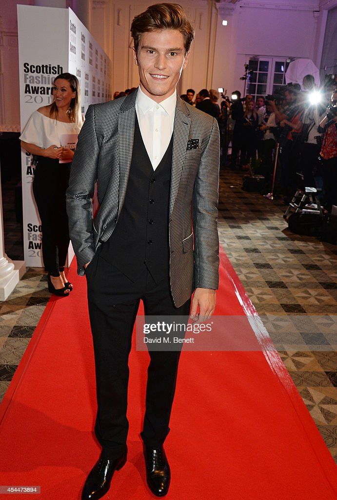 <a gi-track='captionPersonalityLinkClicked' href=/galleries/search?phrase=Oliver+Cheshire&family=editorial&specificpeople=7407100 ng-click='$event.stopPropagation()'>Oliver Cheshire</a> arrives at the Scottish fashion invasion of London at the 9th annual Scottish Fashion Awards at 8 Northumberland Avenue on September 1, 2014 in London, England.
