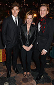 Oliver Cheshire Caroline Scheufele Artistic Director and CoPresident of Chopard and Jamie Campbell Bower attend the Chopard Christmas Party at...