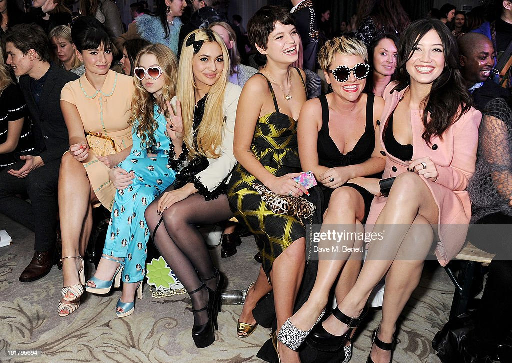 Oliver Cheshire, Gizzi Erskine, Anais Gallagher, Zara Martin, Pixie Geldof, Jaime Winstone and Daisy Lowe attend the Moschino cheap&chic show during London Fashion Week Fall/Winter 2013/14 at The Savoy Hotel on February 16, 2013 in London, England.