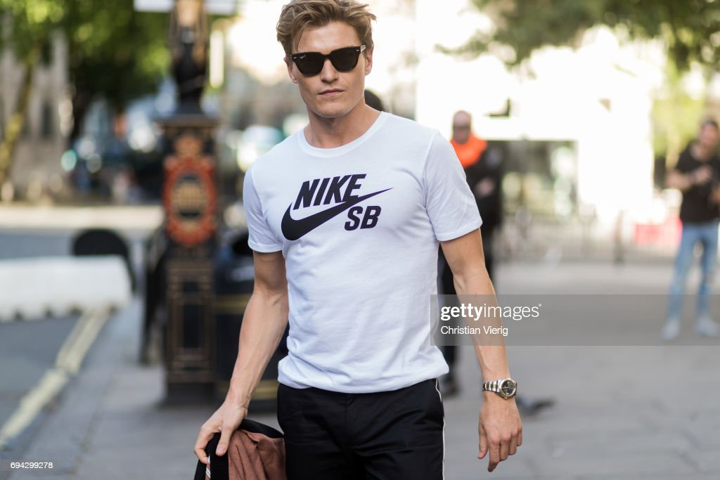 Oliver Cheshire wearing a white Nike tshirt during the London Fashion Week Men's June 2017 collections on June 9, 2017 in London, England.