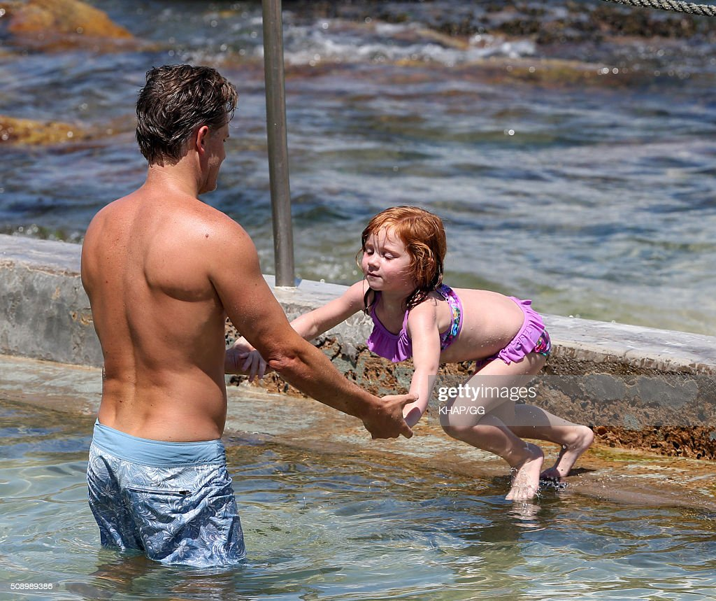 Oliver Curtis and daughter Pixie enjoy beach time on February 7, 2016 in Sydney, Australia.
