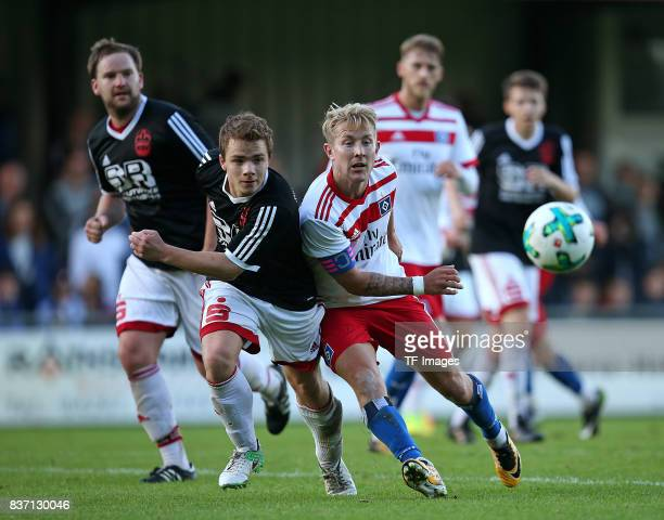Oliver Dittmer of Rotenburg and Yannick Chwolka of Rotenburg and Lewis Holtby of Hamburg battle for the balll during the preseason friendly match...