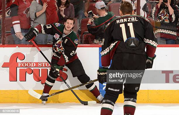 Oliver EkmanLarsson and Martin Hanzal of the Arizona Coyotes warm up while wearing their Kachina jerseys prior to a game against the Edmonton Oilers...