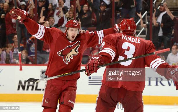 Oliver EkmanLarsson and teammate Keith Yandle celebrate the game winning goal against the Edmonton Oilers at Jobingcom Arena on October 26 2013 in...