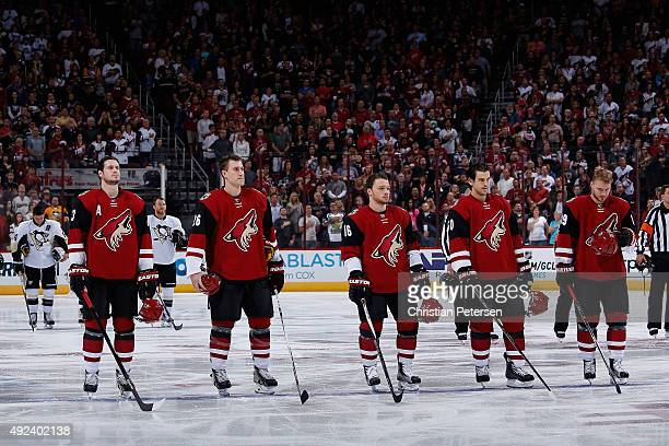 Oliver EkmanLarsson Michael Stone Max Domi Antoine Vermette and Mikkel Boedker of the Arizona Coyotes stand attended for the national anthem before...