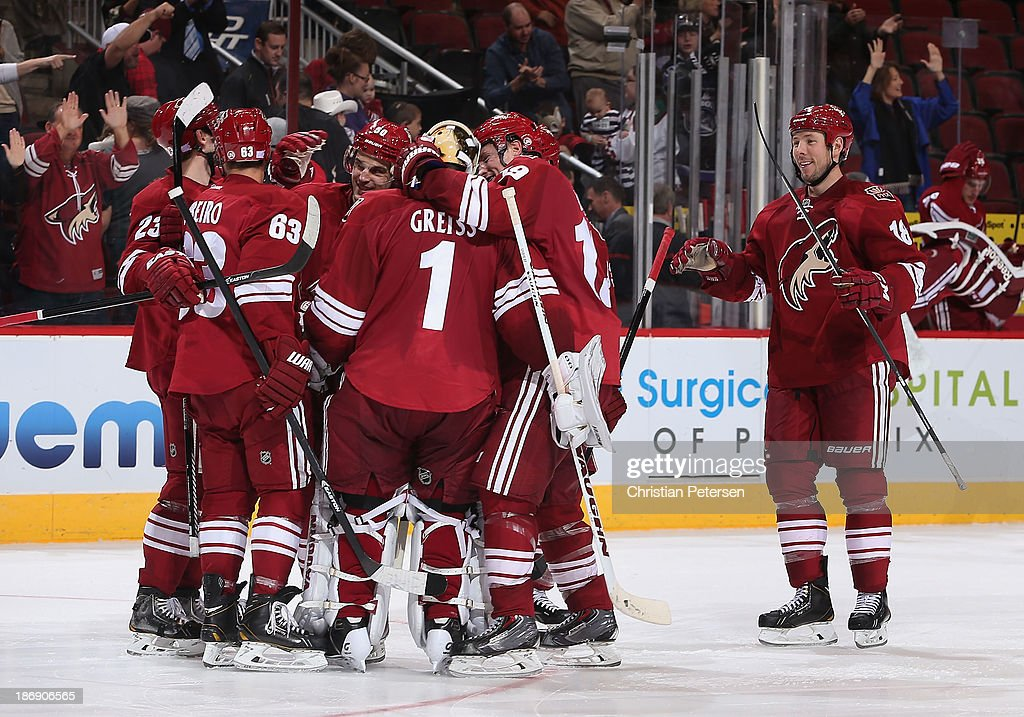 <a gi-track='captionPersonalityLinkClicked' href=/galleries/search?phrase=Oliver+Ekman-Larsson&family=editorial&specificpeople=5894618 ng-click='$event.stopPropagation()'>Oliver Ekman-Larsson</a> #23, Mike Ribeiro #63, Antoine Vermette #50, goaltender <a gi-track='captionPersonalityLinkClicked' href=/galleries/search?phrase=Thomas+Greiss&family=editorial&specificpeople=695275 ng-click='$event.stopPropagation()'>Thomas Greiss</a> #1, <a gi-track='captionPersonalityLinkClicked' href=/galleries/search?phrase=Shane+Doan&family=editorial&specificpeople=201614 ng-click='$event.stopPropagation()'>Shane Doan</a> #19 and David Moss #18 of the Phoenix Coyotes celebrate after defeating the Nashville Predators in the NHL game at Jobing.com Arena on October 31, 2013 in Glendale, Arizona. The Coyotes defeated the Predators 5-4 in an overtime shoot out.