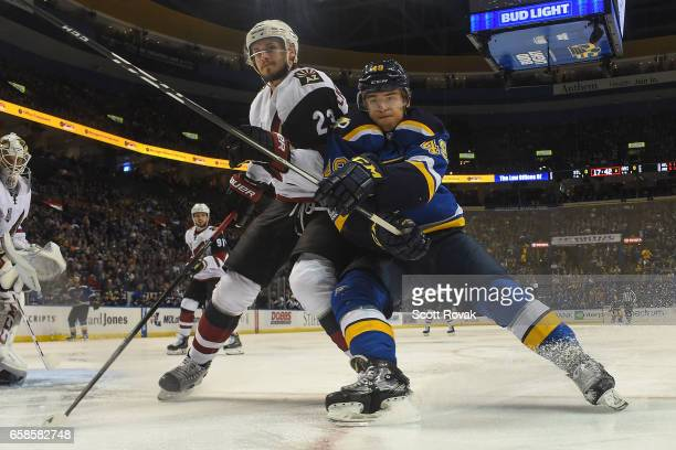 Oliver EkmanLarsson of the Arizona Coyotes and Ivan Barbashev of the St Louis Blues battle for the puck on March 27 2017 at Scottrade Center in St...