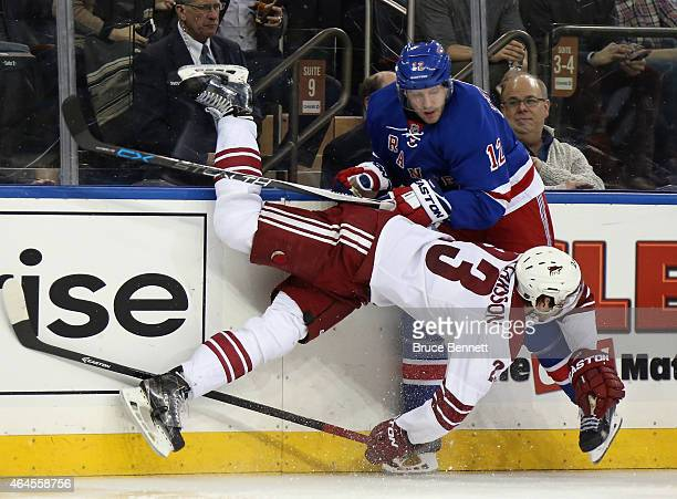 Oliver EkmanLarsson of the Arizona Coyotes and Lee Stempniak of the New York Rangers collide on the boards during the second period at Madison Square...