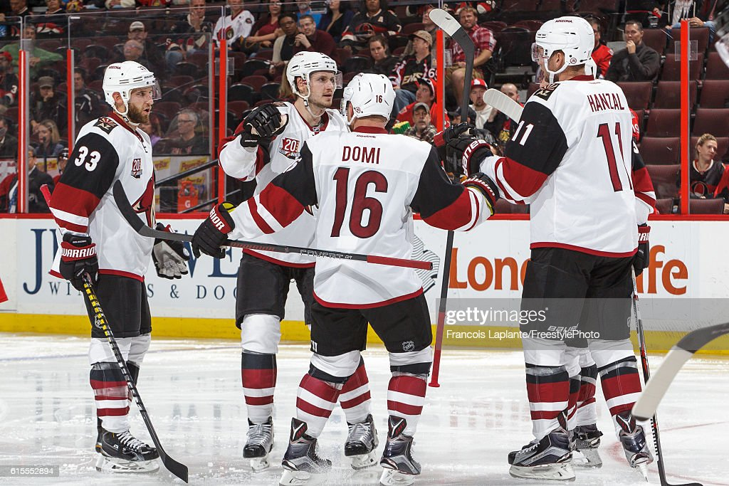 Oliver Ekman-Larsson #23 of the Arizona Coyotes celebrates his goal with teammates Alex Goligoski #33, Max Domi #16, and Martin Hanzal #11 during an NHL game against the Ottawa Senators at Canadian Tire Centre on October 18, 2016 in Ottawa, Ontario, Canada.