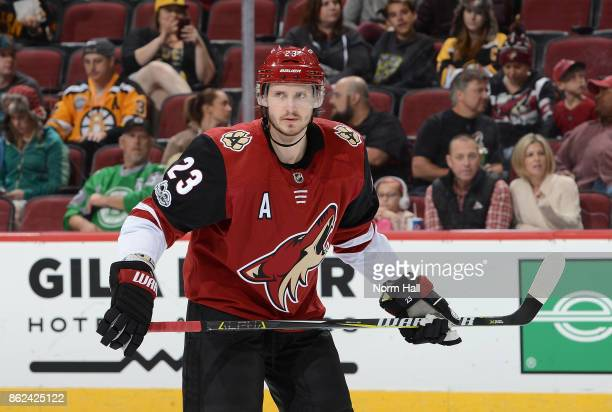 Oliver EkmanLarsson of the Arizona Coyotes gets ready during a faceoff against the Boston Bruins at Gila River Arena on October 14 2017 in Glendale...