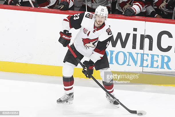Oliver EkmanLarsson of the Arizona Coyotes handles the puck against the Minnesota Wild during the game on December 17 2016 at the Xcel Energy Center...
