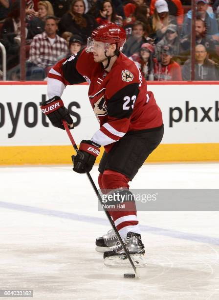 Oliver EkmanLarsson of the Arizona Coyotes passes the puck up ice against the Washington Capitals at Gila River Arena on March 31 2017 in Glendale...